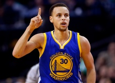 Golden State Warriors guard Stephen Curry heads down the court after making a three point shot during the second half of the Golden State Warriors 106-101 win over the Boston Celtics in an NBA basketball game in Boston, Sunday, March 1, 2015. (AP Photo/Winslow Townson)